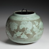 "Celadon jar with floral decoration (8.75"" D.) $450"